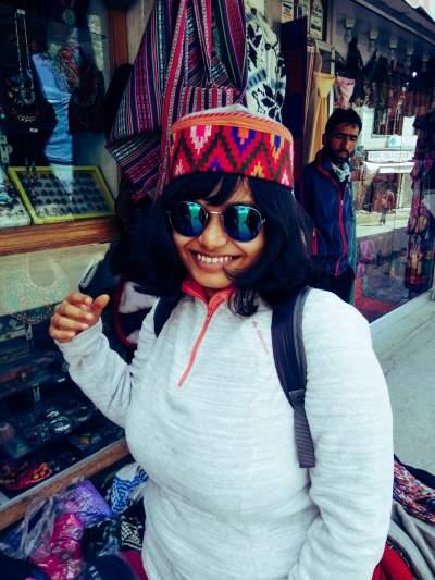 Woman wearing Ladakhi hat